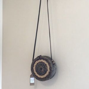 Round rattan and leather purse..